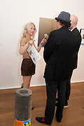 SIGRID WILKINSON; GERRY FOX, Reception of the Silent Auction for the South London Gallery.  Hauser and Wirth. Savile Row. London. 13 October 2011. <br /> <br />  , -DO NOT ARCHIVE-© Copyright Photograph by Dafydd Jones. 248 Clapham Rd. London SW9 0PZ. Tel 0207 820 0771. www.dafjones.com.