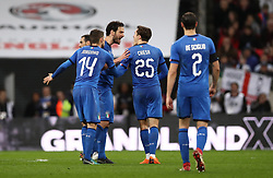 Italy's Marco Parolo (centre) exchanges words with Italy's Federico Chiesa as referee Deniz Aytekin (not pictured) reviews the VAR