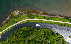 Aerial view  from drone of yacht navigating the  Crinan Canal at Crinan in Argyll & Bute, Scotland, Uk