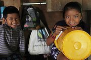 Griselda Peck (right), 9, and her brother Arden, 5, sit in the family room while a Fairtrade tote bag hangs in the background. Griselda and Arden are the youngest children of Justino and Christina Peck. Justino, Mopan Mayan cacao grower from San Jose, Toledo, served as TCGA chairman from 1992 to 1997, once again from 2003 to 2010, and is currently the TCGA's liaison officer. Toledo Cacao Growers' Association (TCGA), San Jose, Toledo, Belize. January 25, 2013.