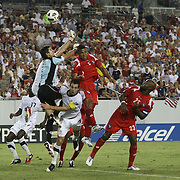USA defender Carlos Bocanegra (3) drives to the net against Panama goalkeeper Jaime Penedo (1) and Panama defender Roman Torres (5) during a CONCACAF Gold Cup soccer match between the United States and Panama on Saturday, June 11, 2011, at Raymond James Stadium in Tampa, Fla. (AP Photo/Alex Menendez)