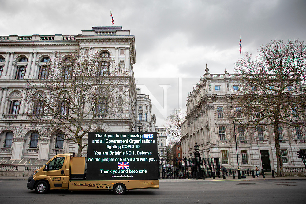 © Licensed to London News Pictures. 20/03/2020. London, UK. An ad van shows a message thanking NHS staff for their work during the Coronovirus pandemic as it drives past Downing Street. Photo credit: Rob Pinney/LNP