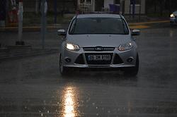 August 4, 2017 - Ankara, Turkey - A headlight of a car illuminates a road during a rainy day in summer in Ankara, Turkey on August 04, 2017. (Credit Image: © Altan Gocher/NurPhoto via ZUMA Press)