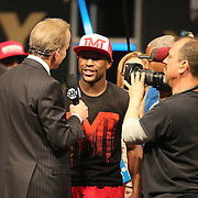 """Floyd Mayweather Jr. talks to the Showtime crew after the official weigh-ins for the Mayweather versus Maidana boxing match slated as """"The Moment"""", at the MGM Grand hotel on Friday, May 2, 2014 in Las Vegas, Nevada.  (AP Photo/Alex Menendez)"""
