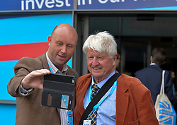 Stanley Johnson, father of Prime Minister and party leader Boris Johnson, poses for a selfie with a fan at the Conservative Party conference in Manchester.<br /> <br /> © Dave Johnston / EEm