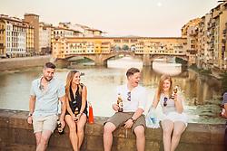 Tourists enjoying drinks at Ponte Santa Trinita at sunset, Florence, Italy. 28/08/15. Photo by Andrew Tallon