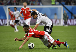 SAINT PETERSBURG, June 19, 2018  Alexandr Samedov (bottom) of Russia vies with Tarek Hamed of Egypt during a Group A match between Russia and Egypt at the 2018 FIFA World Cup in Saint Petersburg, Russia, June 19, 2018. Russia won 3-1. (Credit Image: © Chen Yichen/Xinhua via ZUMA Wire)
