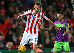 Stoke City's Peter Crouch and Bristol City's Jack Hunt during the Sky Bet Championship match at the bet365 Stadium