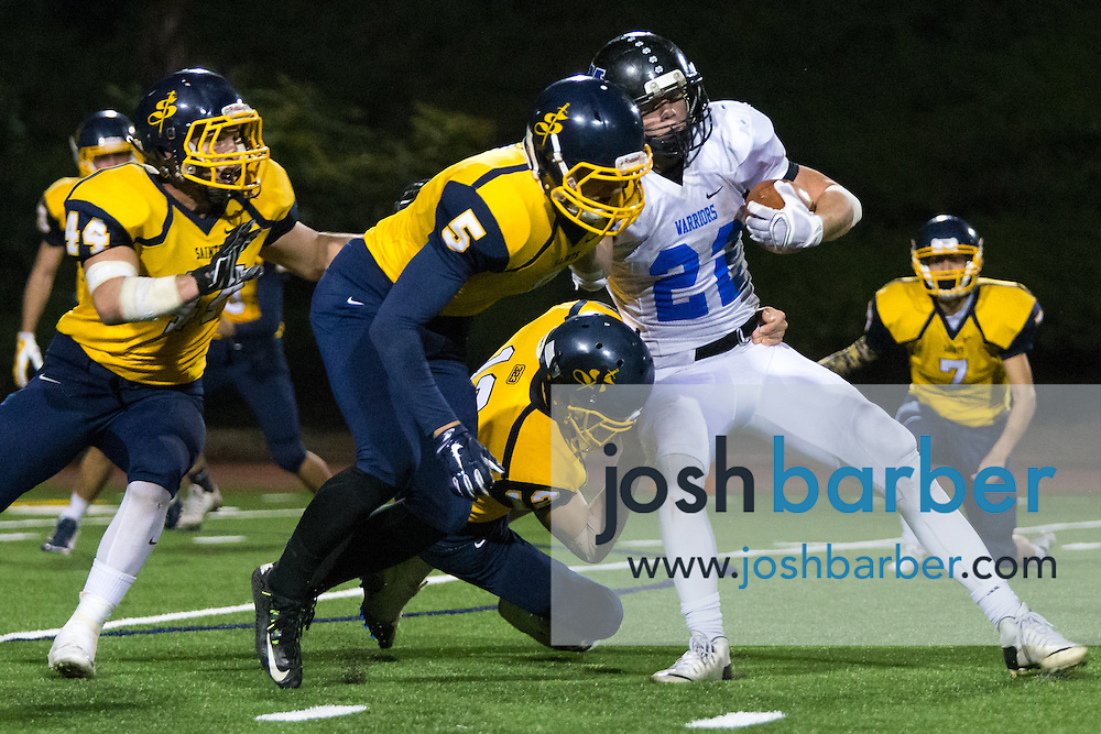 Crean Lutheran's Patrick Mcnerney (5), Zach Macadam (12), Calvary Chapel of Murrieta's Micah Roth (22) during the CIF-SS East Valley Divison Second Round  at Irvine High School on Friday, November 20, 2015 in Irvine, California. (Photo/Josh Barber)