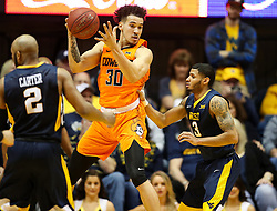Feb 10, 2018; Morgantown, WV, USA; Oklahoma State Cowboys guard Jeffrey Carroll (30) receives a pass during the second half against the West Virginia Mountaineers at WVU Coliseum. Mandatory Credit: Ben Queen-USA TODAY Sports
