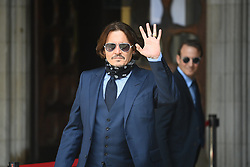 © Licensed to London News Pictures. 14/07/2020. London, UK. American Actors JOHNNY DEPP and AMBER HEARD arrives at the High Court in London where Depp is in a legal dispute with UK tabloid newspaper The Sun over allegations he assaulted his former wife, Amber Heard. Photo credit: Ben Cawthra/LNP
