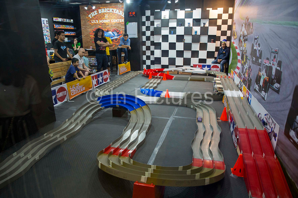 Racing cars on a model race track in Lil's Hobby Center inside Glorietta Mall, Makati, Metro Manila, Philippines. Lil's Hobby Center have been providing consumers with scale models for over 40 years in the Philippines.