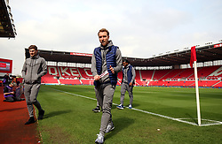 Tottenham Hotspur's (left-right) Ben Davies and Christian Eriksen check out the pitch before the Premier League match at the bet365 Stadium, Stoke.