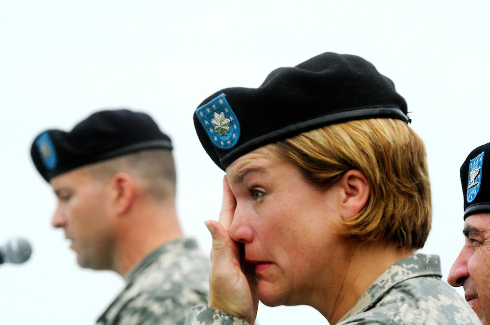 (staff photo by Matt Roth)..Outgoing commander of Headquarters Command Battalion Lt. Col. Ann Huntington-Lozis has an emotional reaction while her replacement, Lt. Col. Thomas A. Boone, makes remarks during the change of command ceremony at McGlachlin Parade Field Friday, June 26, 2009.