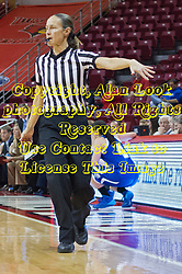 03 January 2014:  Referee Lisa Mattingly motions for the Redbird bench players to sit down during an NCAA women's basketball game between the Drake Bulldogs and the Illinois Sate Redbirds at Redbird Arena in Normal IL