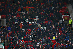 Manchester United fans and empty seats in the stands