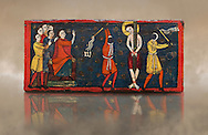 Romanesque painted Beam depicting The Passion and the Stations of the Cross<br /> <br /> Around 1192-1220, Tempera on wood from Catalonia, Spain.<br /> <br /> Acquisition of Museums Board's campaign in 1907. MNAC 15833.<br /> <br /> It is not known what was the original location of the beam, but it might have been part of the structure of a canopy. In any case, it was reused in a ceiling, as evidenced by the cuts that are at the top. It is decorated with seven scenes from the Passion and Resurrection of Christ, this scene shows Christ being whipped on the road to Calvary. The narrative character in the images and the predominance of yellow is typical of Catalan painting of the 1200's,  specifically with illustrations of Liber Feudorum Maior, a late twelfth-century illuminated cartulary book style of the Crown of Aragon .<br /> <br /> If you prefer you can also buy from our ALAMY PHOTO LIBRARY  Collection visit : https://www.alamy.com/portfolio/paul-williams-funkystock/romanesque-art-antiquities.html<br /> Type -     MNAC     - into the LOWER SEARCH WITHIN GALLERY box. Refine search by adding background colour, place, subject etc<br /> <br /> Visit our ROMANESQUE ART PHOTO COLLECTION for more   photos  to download or buy as prints https://funkystock.photoshelter.com/gallery-collection/Medieval-Romanesque-Art-Antiquities-Historic-Sites-Pictures-Images-of/C0000uYGQT94tY_Y