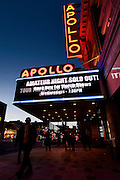 People walk by the famous Apollo theater as the sun sets on the W 125th St. landmark.  Harlem, a neighborhood of New York City in Manhattan, began as a Dutch village in 1658 and was later annexed to New York City in 1873.  At the beginning of the 20th century African-American's began arriving from the southern American states looking for work in the more industrious north.  With their migration, the African-American community brought with them a renaissance in the arts to Harlem that is still evident today.  After World War II Harlem began experiencing a significant rise in crime and poverty due to the Great Depression that lasted until the 21st century.  A new pride in the community has brought a renewed revival to Harlem, and crime rates have dropped to record lows giving the New York City neighborhood a new lease on life.