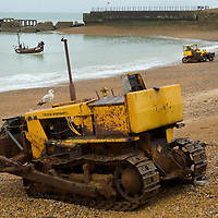 Tractor for hauling from and pushing boats into the sea , Hastings, East wessex, England