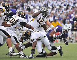 Nov 14, 2009; Manhattan, KS, USA; Kansas State running back Daniel Thomas (8) is brought down in the third quarter by Missouri linebacker Sean Weatherspoon (12) as the Tigers defeat the Wildcats 38-12 at Bill Snyder Family Stadium. Mandatory Credit: Denny Medley-US PRESSWIRE