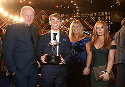 Billy Monger poses his Helen Roll-on Award alongside his parents Rob and Amanda and sister Bonny during the BBC Sports Personality of the Year 2018 at Birmingham Genting Arena.