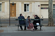 """April, 9th 2020 - Paris, Ile-de-France, France: Parisians self isolating in the hope of protecting themselves from the spread of the Coronavirus, during the first month of near total lockdown imposed in France. A week after President of France, Emmanuel Macron, said the citizens must stay at home for at least 15 days, that has been extended. He said """"We are at war, a public health war, certainly but we are at war, against an invisible and elusive enemy"""". All journeys outside the home unless justified for essential professional or health reasons are outlawed. Anyone flouting the new regulations is fined. Nigel Dickinson"""