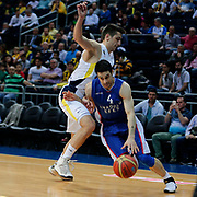Anadolu Efes's Dogus Balbay (R) during their Turkish Basketball League match Fenerbahce Ulker between Anadolu Efes at the Ulker Sports Arena in Istanbul, Turkey, Sunday 26 April, 2015. Photo by Aykut AKICI/TURKPIX