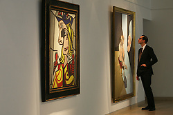 © Licensed to London News Pictures 10/04/2013.A Christie's employee admires Francis Bacon's painting 'Study for Portrait' (estimated between $18 -$25 million) that hungs next to Roy Lichenstein's 'Woman with Flowereed Hat' (estimated at $30 million), are some of the major works on display at Christie's in central London, and due to go on auction on 15th May in New York. .London, UK.Photo credit: Anna Branthwaite
