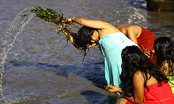 August 26, 2017 - Kathmandu, Nepal - Hindu woman baths during Rishi Panchami festival in Kathmandu. Rishi Panchami festival marks the end of the three-day Teej festival when women worship Sapta Rishi (Seven Saints) and pray for health for their husband while unmarried women wish for handsome husband and happy conjugal lives. (Credit Image: © Sunil Sharma/Xinhua via ZUMA Wire)