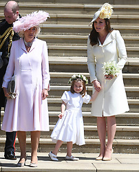 © Licensed to London News Pictures. 19/05/2018. London, UK.  CAMILLA DUCHESS OF CORNWALL, PRINCESS CHARLOTTE and CATHERINE, DUCHESS OF CAMBRIDGE at the wedding of Prince Harry, The Duke of Sussex and Meghan Markle, The Duchess of Sussex at St George's Chapel in Windsor Castle. Photo credit: LNP