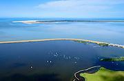 Nederland, Groningen, Gemeente de Marne, 05-08-2014; Lauwersoog met Lauwersmeer (voormalige Lauwerszee) en de Lauwerssluizen, de  R.J. Cleveringsluizen. Deze spuisluizen zijn uitwaterende sluizen tussen het meer en de Waddenzee.<br /> Schiermonnikoog aan de horizon.<br /> <br /> Lauwers Lake, former Lauwers Sea on the border between Groningen and Friesland (north Netherlands).<br /> luchtfoto (toeslag op standard tarieven);<br /> aerial photo (additional fee required);<br /> copyright foto/photo Siebe Swart