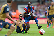 Francis Coquelin of Arsenal fouls Yannick Bolasie of Crystal Palace. Barclays Premier league match, Crystal Palace v Arsenal at  Selhurst Park in London on Sunday 16th August 2015.<br /> pic by John Patrick Fletcher, Andrew Orchard sports photography.