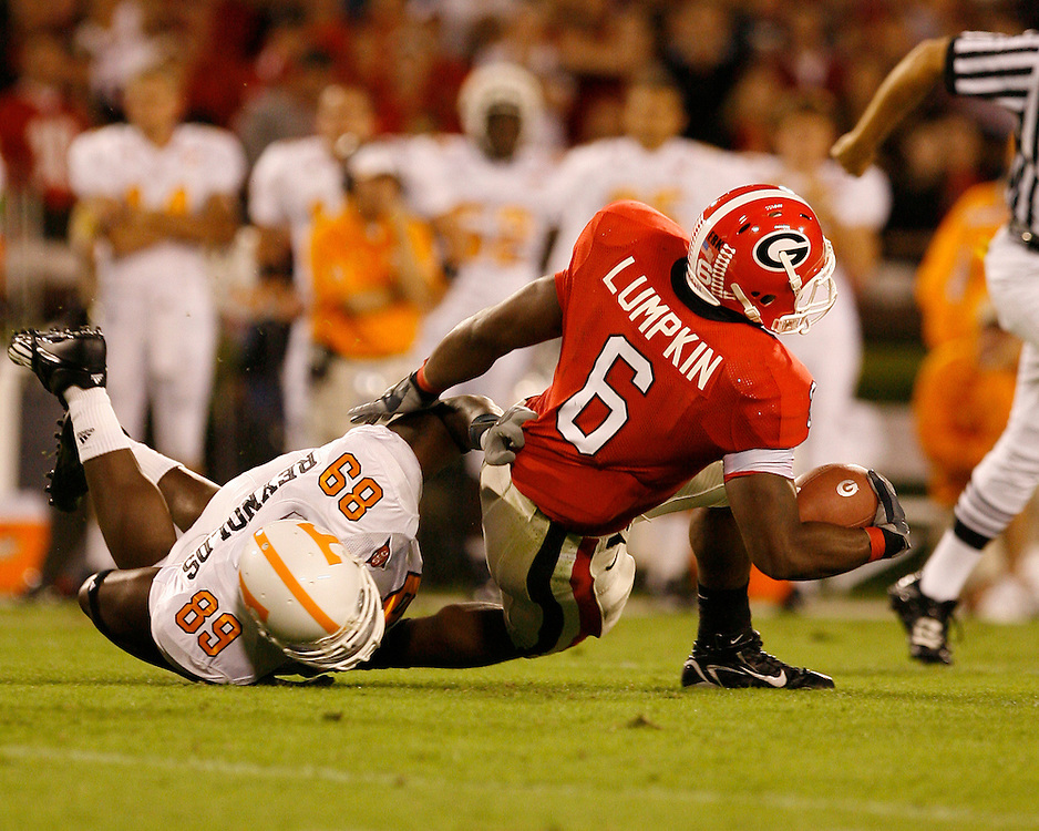 Tennessee DE Antonio Reynolds tackles Georgia RB Kregg Lumpkin during the game between the Georgia Bulldogs and the Tennessee Volunteers at Sanford Stadium in Athens, GA on October 7, 2006.<br />