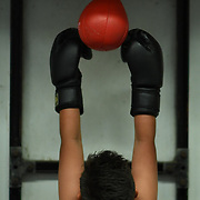 Just within reaching range, Nicholas uses the speed bag at La Habra Boxing Club on May 5, 2017. -- <br /> <br /> Photo by Megan Fenwick / Sports Shooter Academy