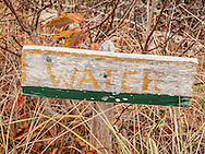 This sign marks the way to the hand pump at the C-Scape dune shack.