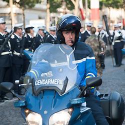 Motard de la Gendarmerie Nationale sur l'avenue des Champs Elysées à l'occasion des célébrations de la fête nationale.<br /> 14 juillet 2013, Paris (75)