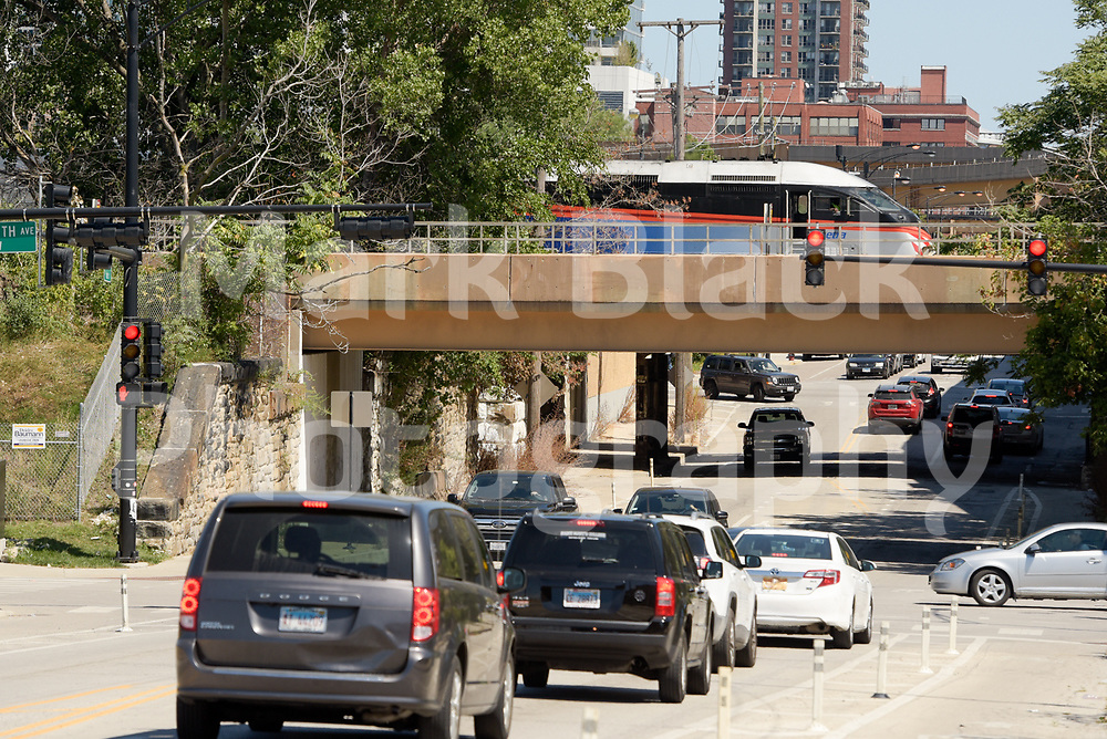 A Metra Train crosses the 18th Street bridge in the Chinatown neighborhood of Chicago on Wednesday, Aug. 19, 2020.  Photo by Mark Black