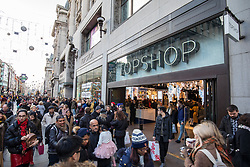© Licensed to London News Pictures. 25/11/2017. London, UK. Topshop on Oxford Street open shortly after the building was evacuated earlier today. Security staff have said that the evacuation was a fire drill. Many shops on Oxford Circus were evacuated yesterday after a security scare caused by two people fighting at Oxford Circus tube station. Photo credit: Rob Pinney/LNP