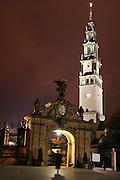 Czestochowa, Poland. Jasna Gora Monastery (Black Madonna) at night with gate and church tower illuminated.