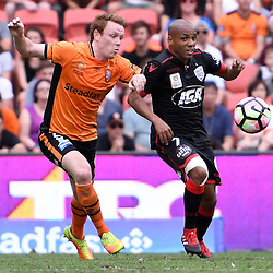 BRISBANE, AUSTRALIA - DECEMBER 11: Corey Brown of the Roar and Henrique of Adelaide United compete for the ball during the round 10 Hyundai A-League match between the Brisbane Roar and Adelaide United at Suncorp Stadium on December 11, 2016 in Brisbane, Australia. (Photo by Patrick Kearney/Brisbane Roar)