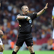 Referee's Tolga OZKALFA during their Turkish Super League soccer match Galatasaray between Eskisehirspor at the TT Arena at Seyrantepe in Istanbul Turkey on Monday, 26 September 2011. Photo by TURKPIX