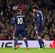 Manchester United's Wayne Rooney has words with Marouane Fellaini<br /> <br /> Barclays Premier League- Arsenal vs Manchester United - Emirates Stadium - England - 22nd November 2014 - Picture David Klein/Sportimage