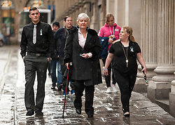 © Licensed to London News Pictures. 13/11/2015. Bristol, UK.  DENISE GALSWORTHY (C) the Step-Grandmother of murder victim Rebecca Watts arrives at Bristol Crown Court on the day Nathan Matthews is sentenced for the murder of Rebecca Watts.  Photo credit : Simon Chapman/LNP