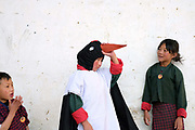 A child from Bayta Primary School dressed as a crane before performing the Black-necked Crane dance 'Ngachey Thrung Thrung Detshu' at the Black-necked Crane Festival at Gangte Goemba, Phobjikha Valley, Bhutan. Every year on November 11th, the local community hosts the festival at Gangte Goemba to highlight the cranes significance to the valley. Phobjikha Valley is the most significant overwintering ground of the rare and endangered Black-necked Crane in Bhutan.