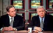 Investigative reporters of Watergate fame Bob Woodward (L) and Carl Bernstein discuss the impeachment of President Clinton during NBC's Meet the Press December 13, 1998 in Washington, DC.