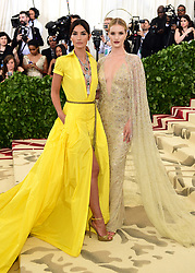 Lily Aldridge (left) and Rosie Huntington-Whiteley attending the Metropolitan Museum of Art Costume Institute Benefit Gala 2018 in New York, USA.