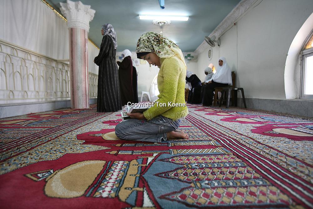An Iraqi girl praying in a mosque in Amman, Jordan
