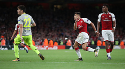 Arsenal's Alexis Sanchez (centre) scores his side's first goal of the game during the Europa League match at the Emirates Stadium, London.