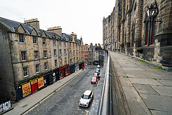 Edinburgh, Scotland, UK. 16 June, 2020. As shops open in England, Scottish shops and businesses remain closed, Streets are empty and pubs and shops are still closed with many boarded up. Bars might be allowed to open outside areas at end of week but currently they are only-permitted  to serve drinks to takeaway. Pictured; Victoria Street in the Old Town is deserted. Iain Masterton/Alamy Live View.
