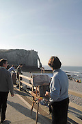 France, Normandy, Coast, Etretat, Porte d'Aval Arch painter paints the arch